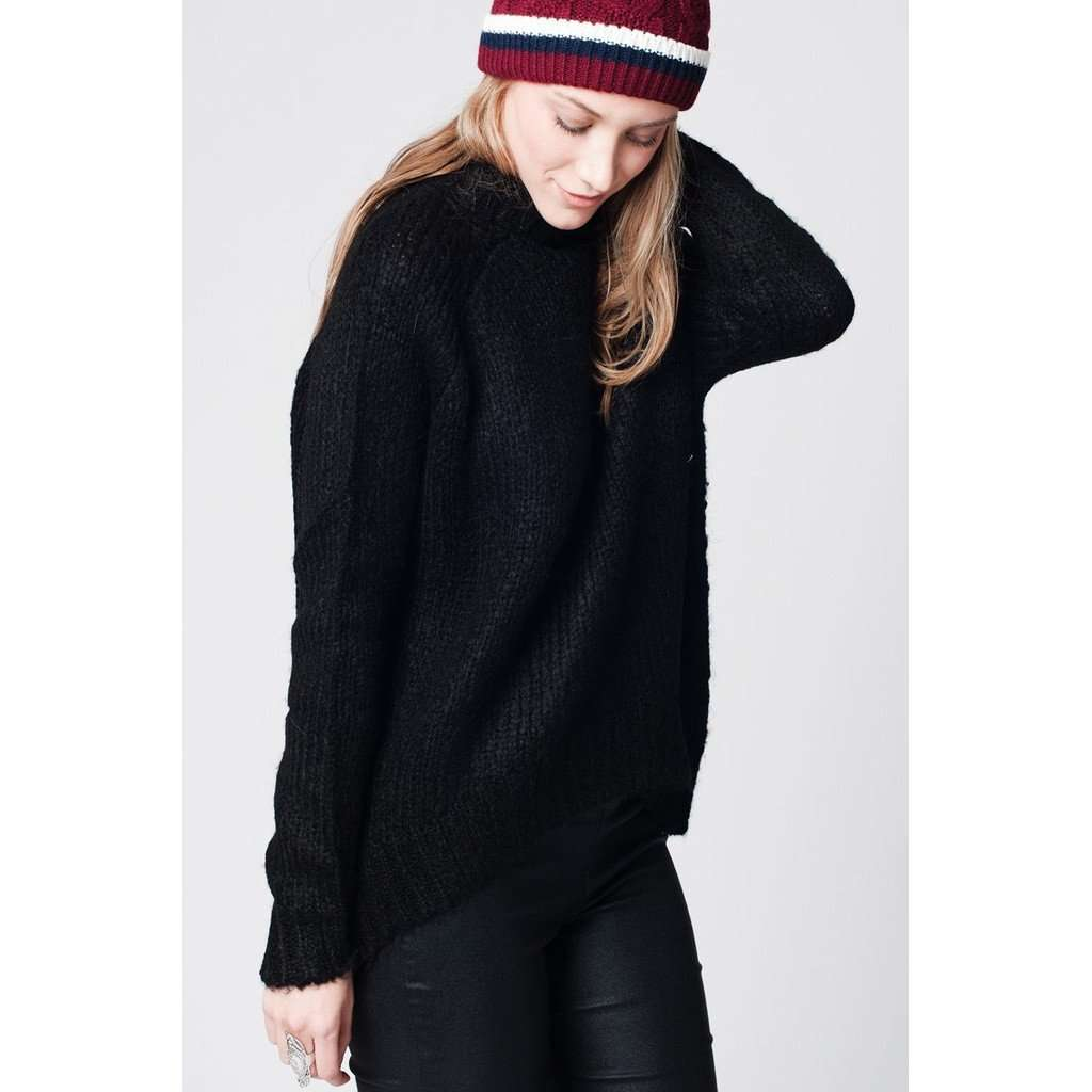 Black asymmetric wool knit sweater with ribbed turtle neck CoolHatcher at TheArtOfLiving.Earth