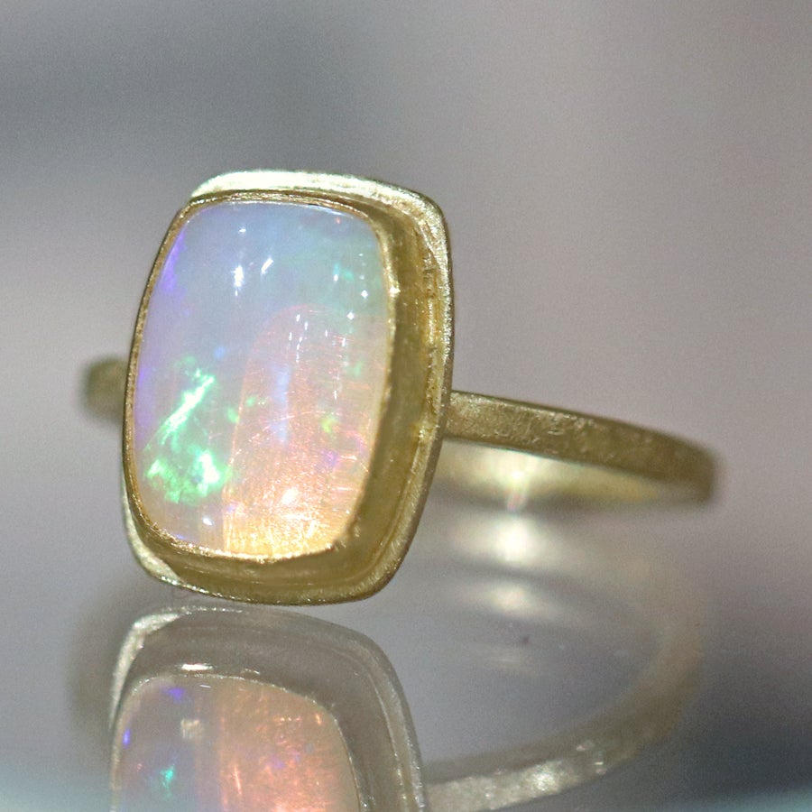 Petra Class Fiery Rainbow Ethiopian White Opal Cabochon Framed Matte Gold Ring - Szor Collections
