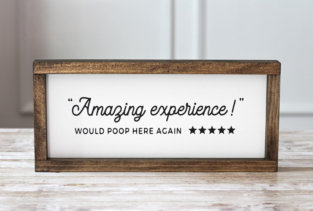 Amazing experience would poop here again bathroom wall sign