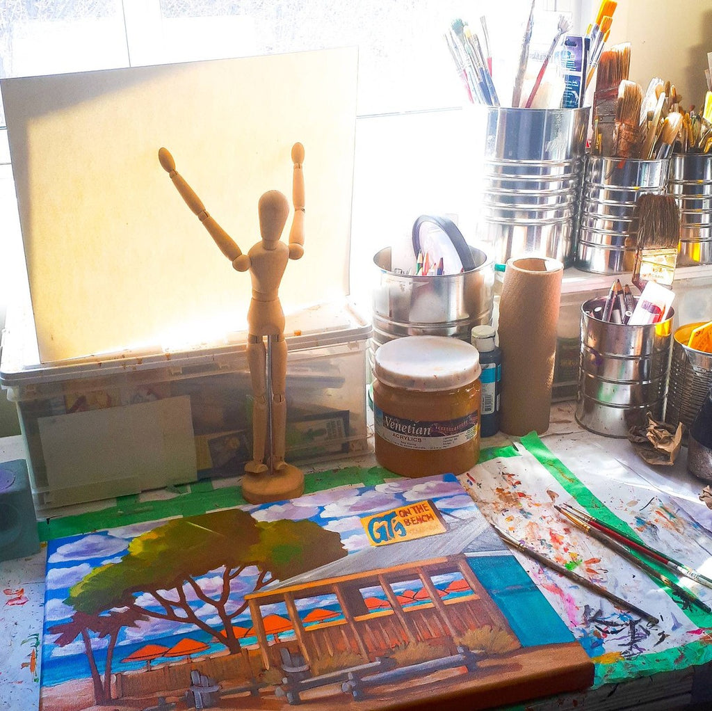 painting table with wooden figure