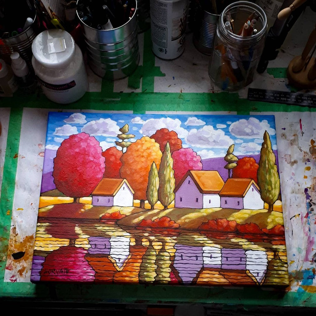 original painting on art studio table