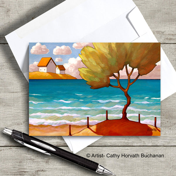 greeting card of a lone tree on a beech with an envelope and pen, greeting card by artist Cathy Horvath Buchanan,