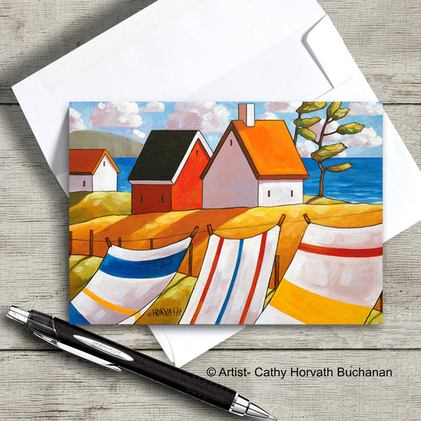 colorful towels in the wind and coastal cottages art card with envelope