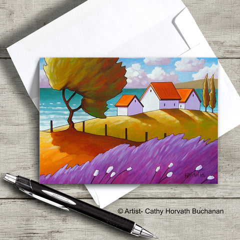 colorful coastal landscape with windy tree and lavender white cottages art card with envelope