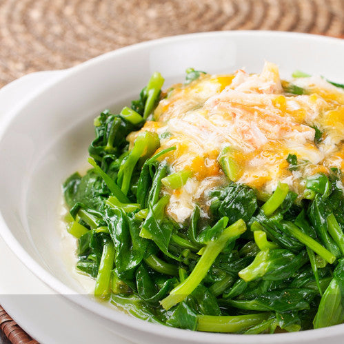 Stir fried snow pea leaves with duck egg and preserved egg