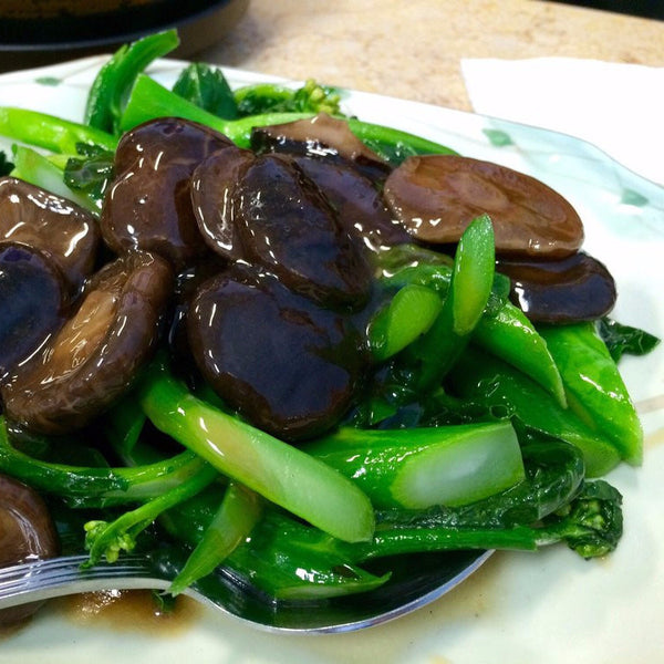 Chinese broccoli with Chinese mushrooms - Restaurant PM