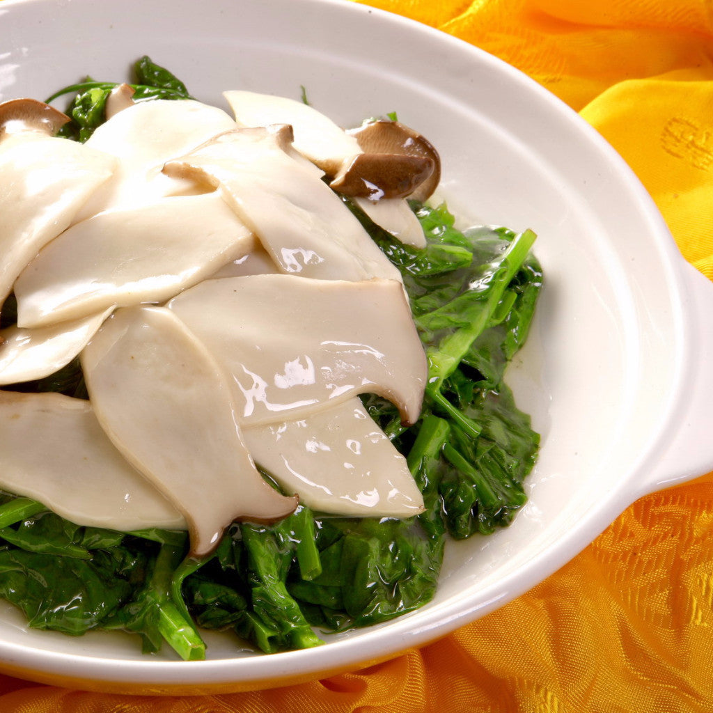 Stir fried snow pea leaves with king mushrooms - Restaurant PM