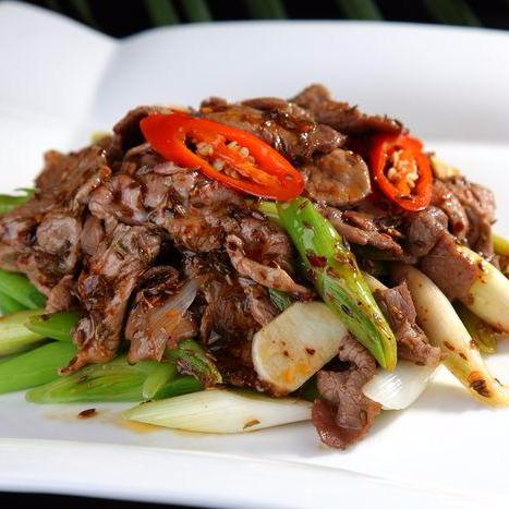Stir fried sliced lamb with sugar peas in XO chili sauce
