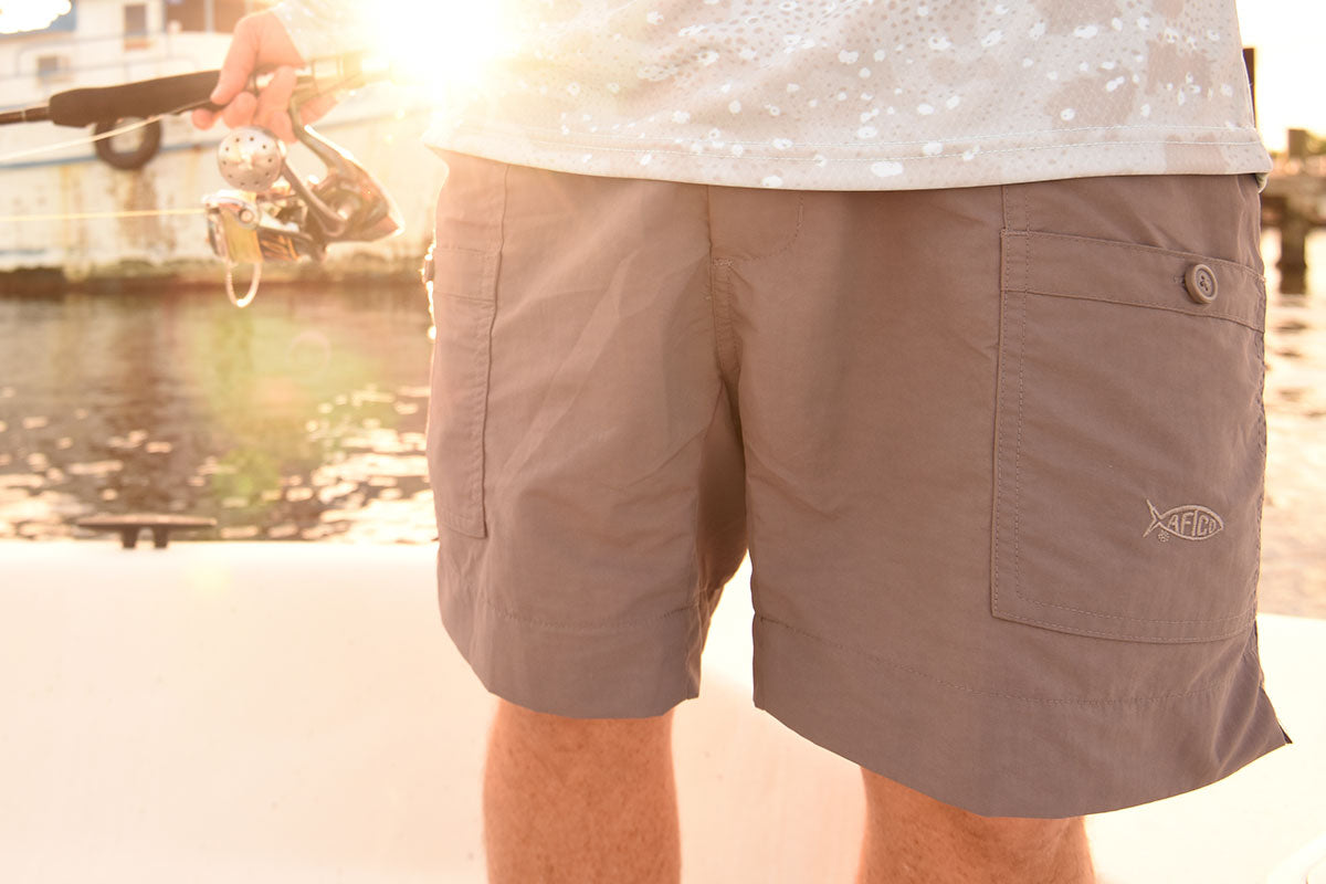 38dafe7046 27 bar tacks keep these fishing shorts strong in all the right places. AFTCO  embroidery on left pocket. 16