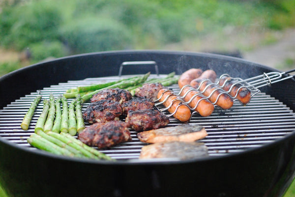 meat and vegetables on a round grill