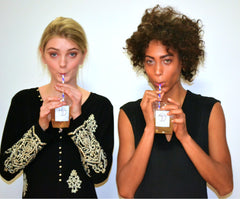 Models sipping Big T NYC organic couture cold brew tea backstage New York Fashion Week Yoana Baraschi presentation 2014