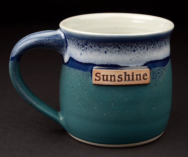 16 oz. green-blue mug with personalization.