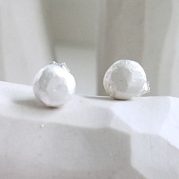 White studs sterling silver earrings, faceted pebbles round