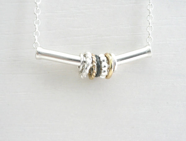 Sterling Silver Necklace with Silver and 14 k Goldfilled Spinners