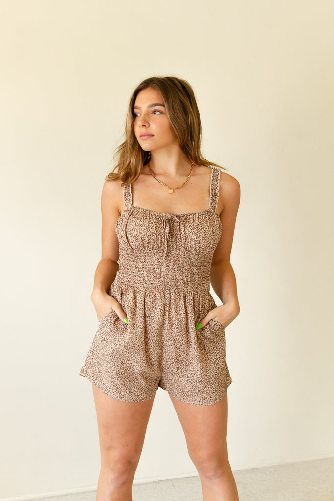brown animal print sleeveless romper with pockets
