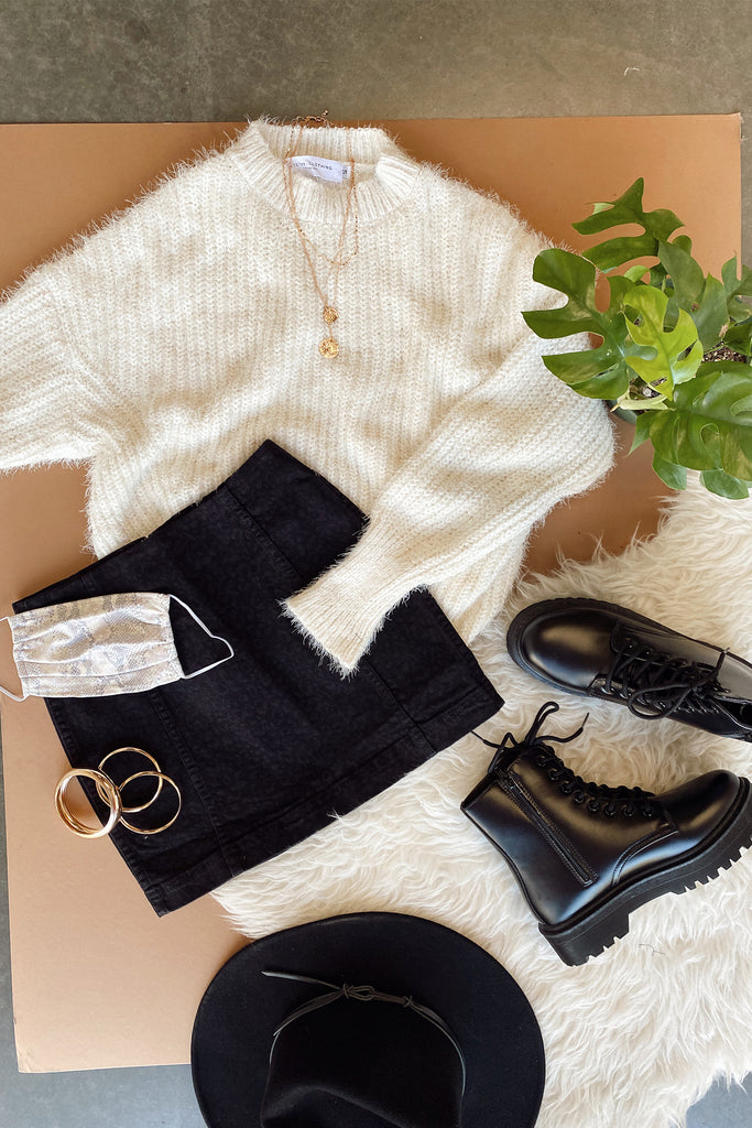 white ribbed knit pullover sweater