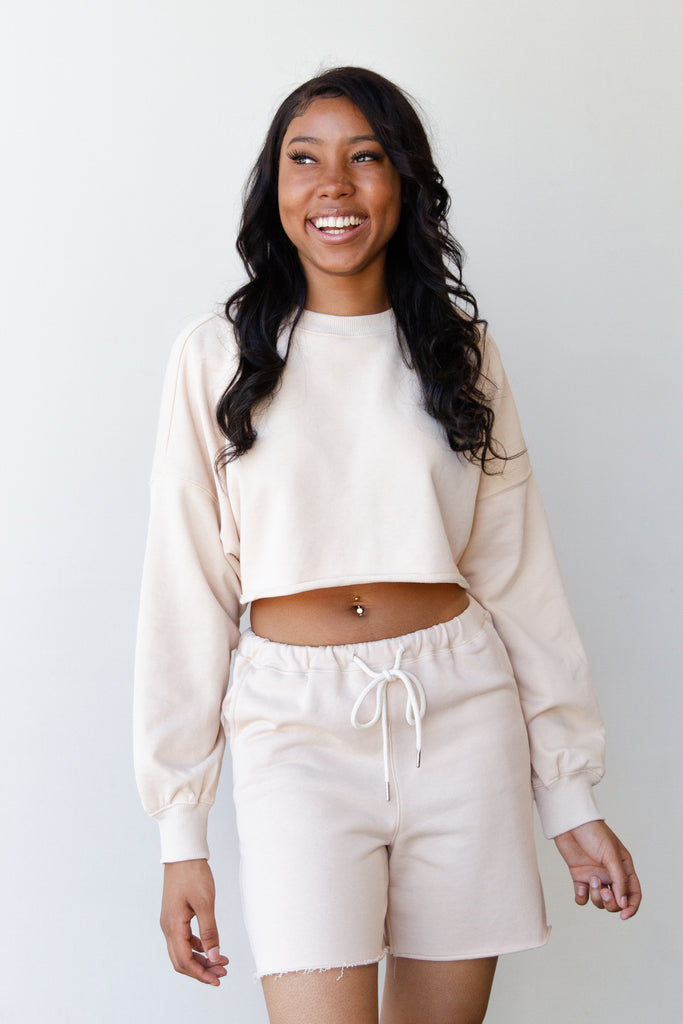 cropped raw hem natural sweater
