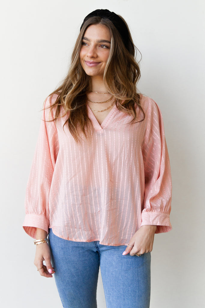pink striped long sleeve top