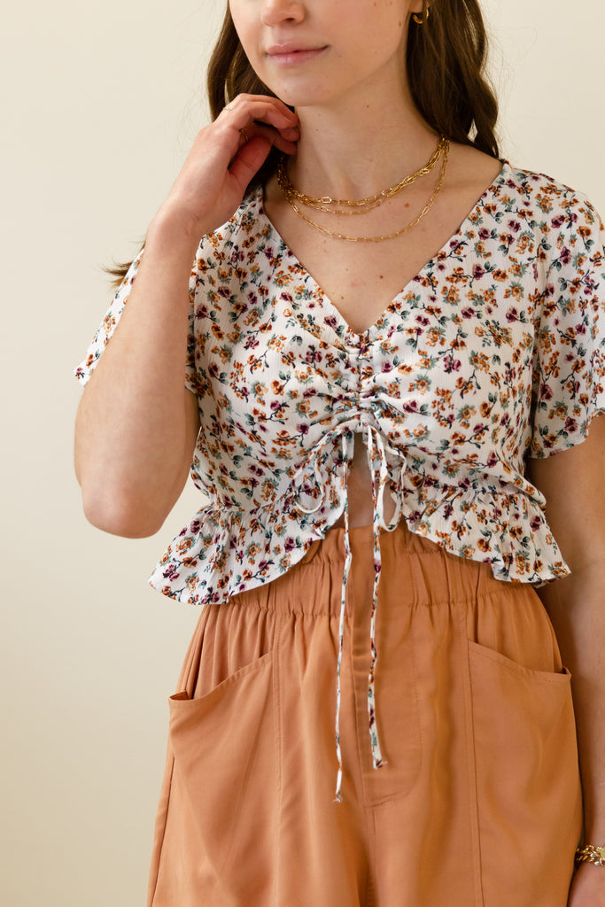 cinched white floral crop top