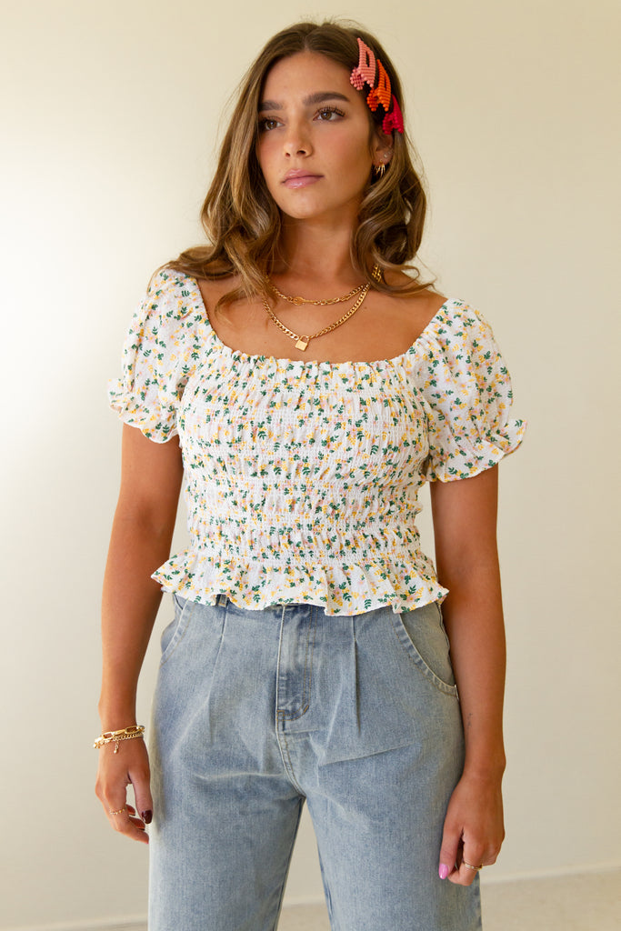 white smocked floral crop top with ruffle hem