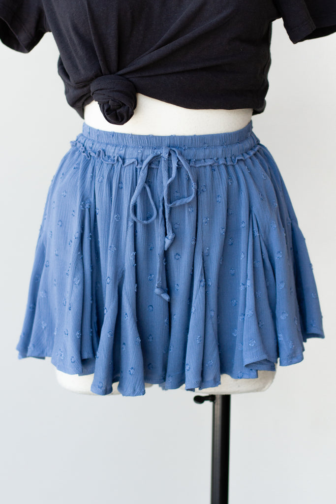 blue ruffled shorts