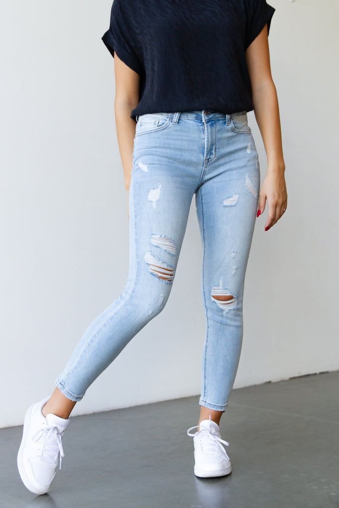 light wash mid rise distressed denim jeans