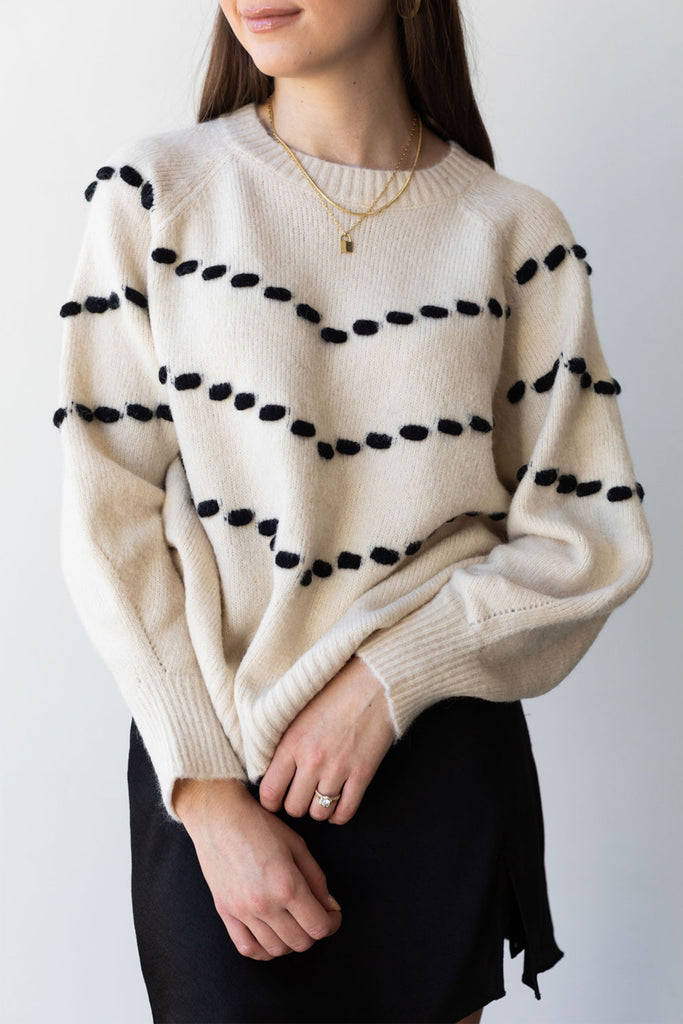 cream patterned knit sweater