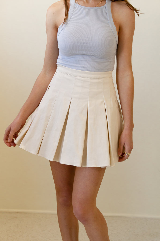 cream pleated skort