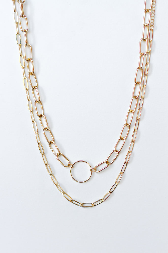 gold overlapping chain necklace with circular pendant