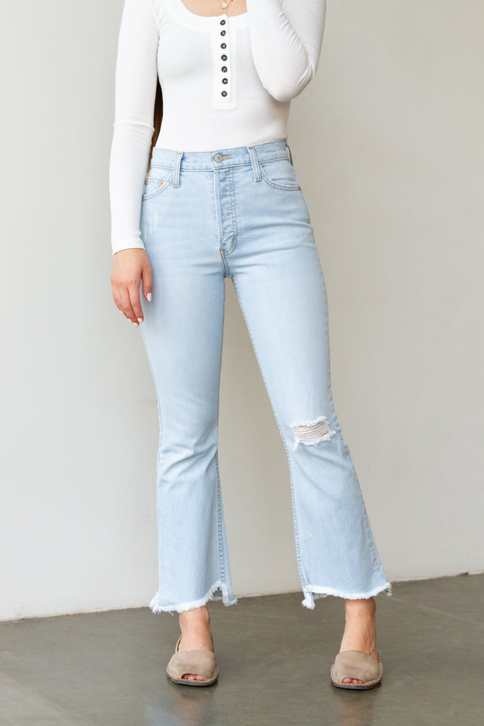 light wash distressed bell bottom jeans