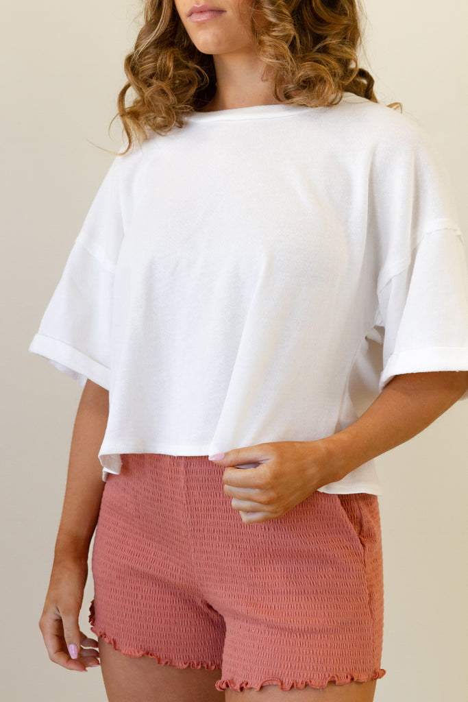 white short sleeves boxy crop top with asymmetrical back design