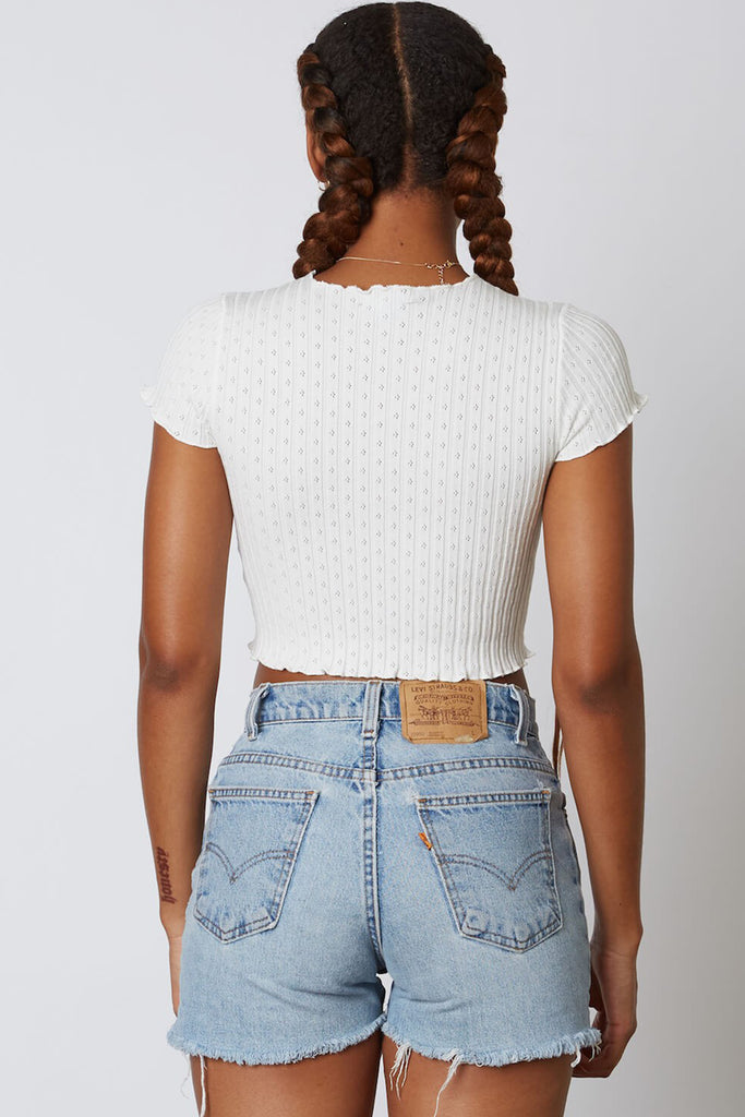 white ruffled hem crop top
