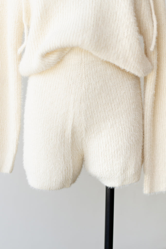 fuzzy cream biker shorts