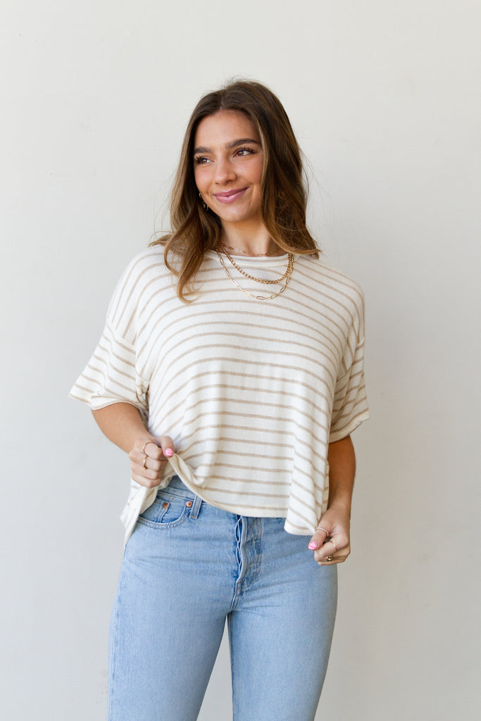 cream/tan striped top