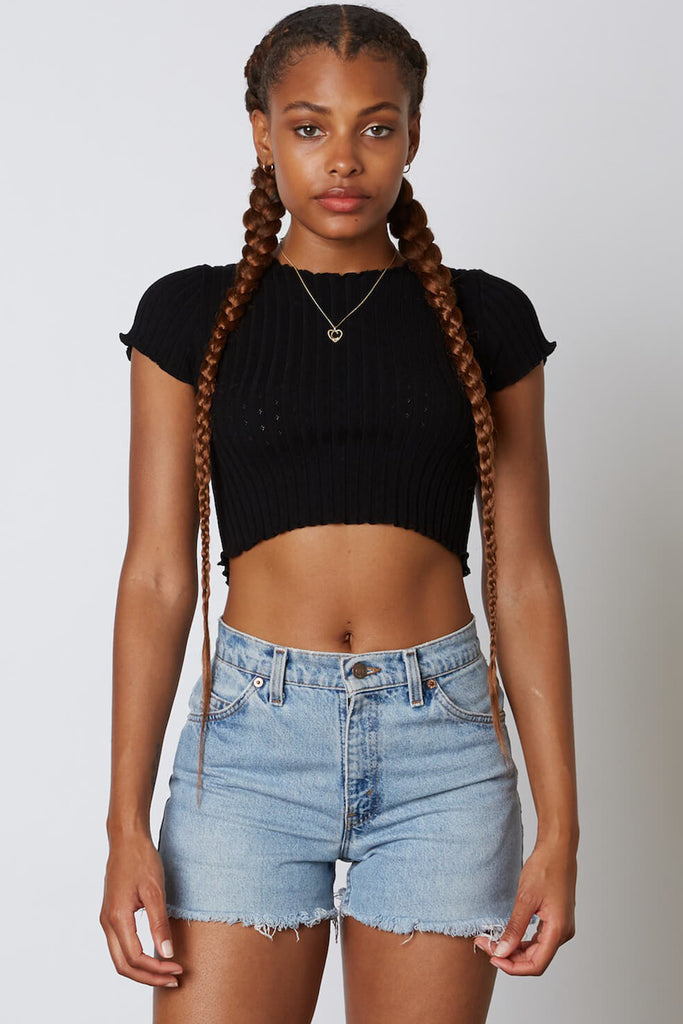 black ruffled hem crop top