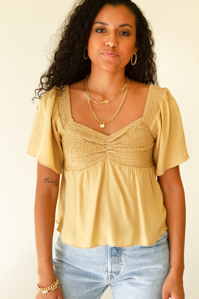 mustard smocked crop top with short sleeves