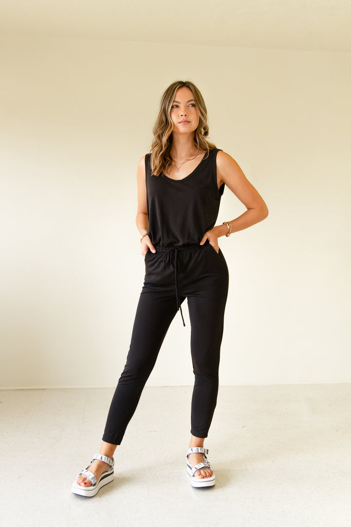 black sleeveless jumpsuit with drawstring waist
