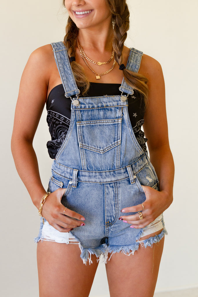 light wash distressed overall shorts