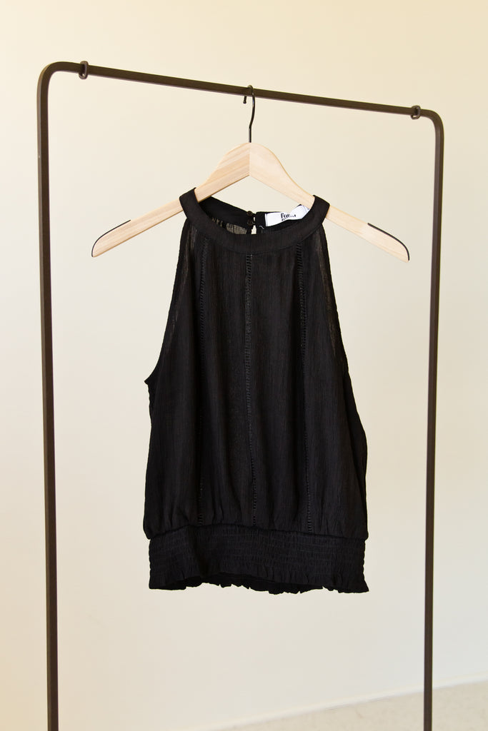 black high neck sleeveless top with smockced waist