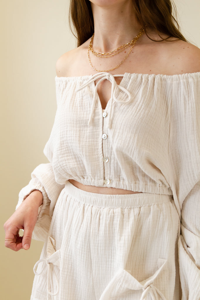 cream ots crop top