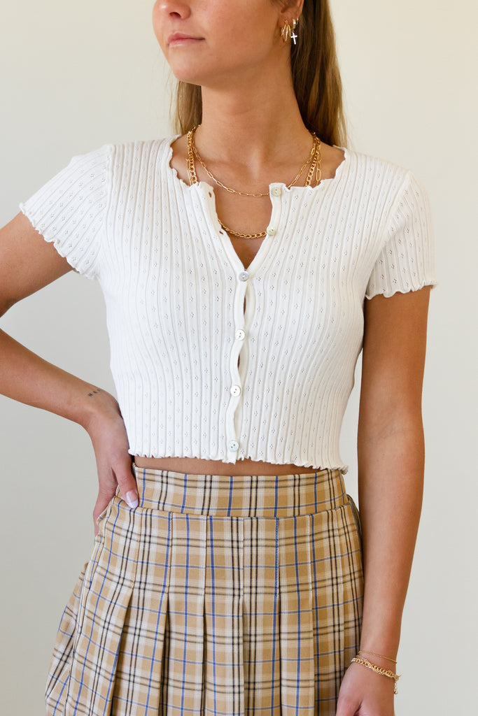 white short sleeve ribbed lettuce hem button up crop top