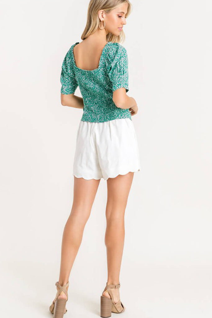 green/white floral top