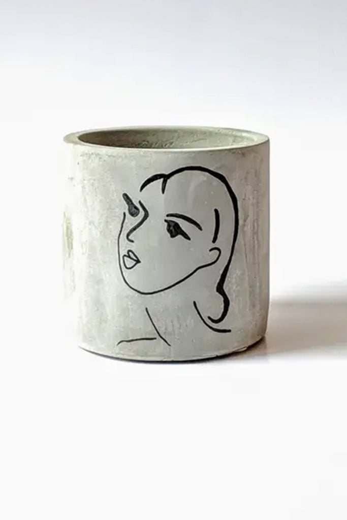 woman's face ceramic planter