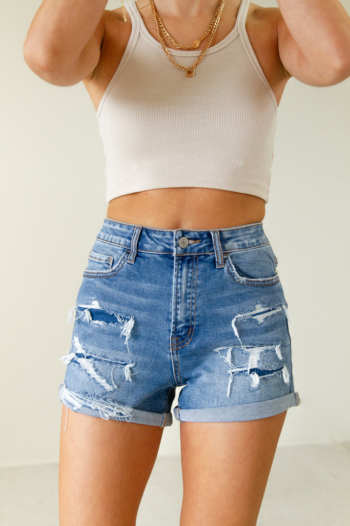 The Olivine High Rise Distressed Denim Shorts by Nectar Premium Denim