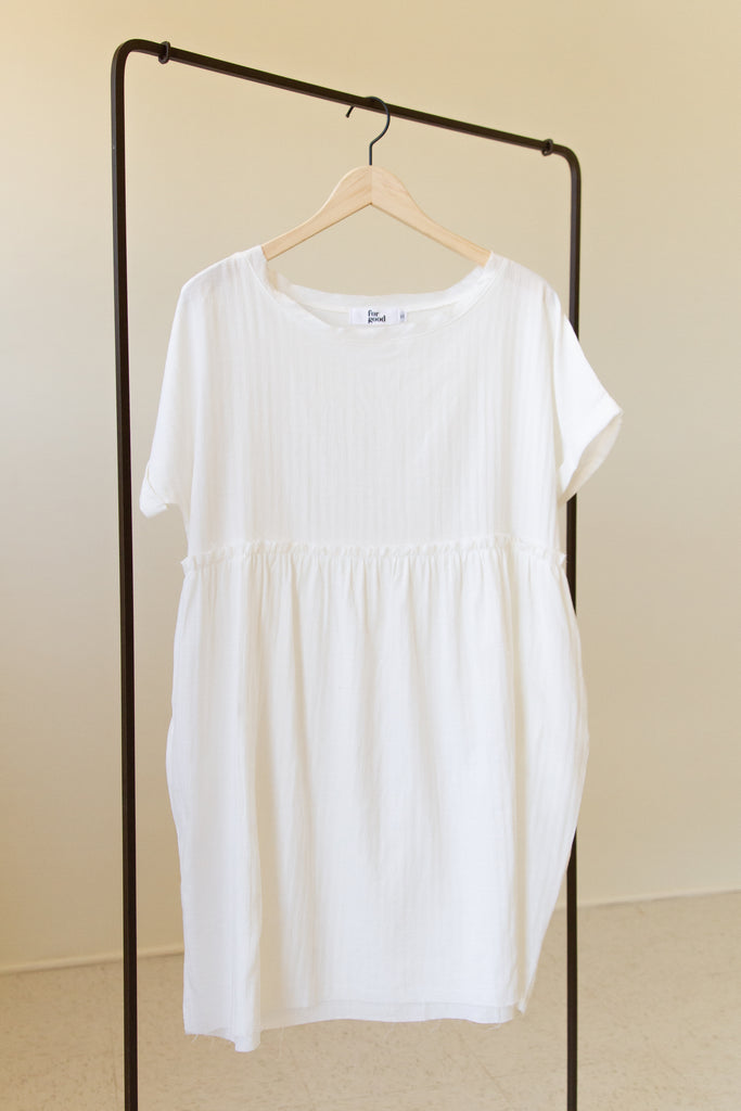 white babydoll dress with round neckline & short sleeves