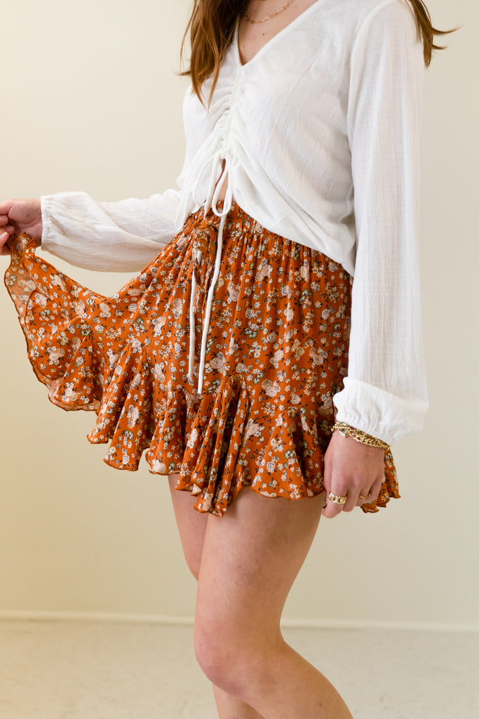 rust floral ruffle shorts