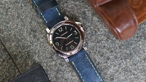 Panerai luminor on blue suede with green stitching
