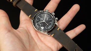 Dark brown pull up on Omega speedmaster reduced