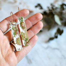 Load image into Gallery viewer, These gorgeous earrings feature handpicked pressed flowers preserved in the high-quality jewelry grade resin and sterling silver ear-wires.