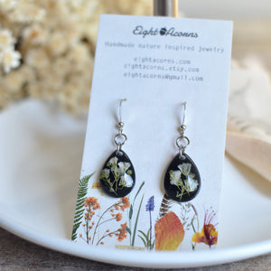 These are small teardrop earrings featured encased pressed Gypsophila or better known as baby's breath.